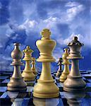Chess Pieces on Checkerboard And Sky    Stock Photo - Premium Rights-Managed, Artist: Nora Good, Code: 700-00049631