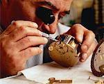 Close-Up of Male Watchmaker Repairing Clock    Stock Photo - Premium Rights-Managed, Artist: Dan Lim, Code: 700-00051349