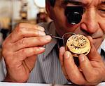 Close-Up of Male Watchmaker Repairing Clock    Stock Photo - Premium Rights-Managed, Artist: Dan Lim, Code: 700-00051350