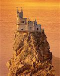 Altered View of Castle on Top of Rock in Ocean at Sunset    Stock Photo - Premium Rights-Managed, Artist: Peter Christopher, Code: 700-00051483