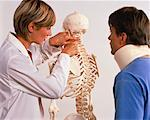 Female Physiotherapist and Male Patient Looking at Skeleton    Stock Photo - Premium Rights-Managed, Artist: Masterfile, Code: 700-00051511