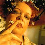 Close-Up of Woman in Vintage Hair Curlers Smoking Cigarette    Stock Photo - Premium Rights-Managed, Artist: Brian Kuhlmann, Code: 700-00051769