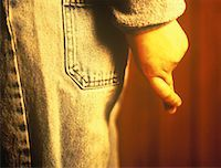 Close-Up of Child Crossing Fingers Behind Back    Stock Photo - Premium Rights-Managednull, Code: 700-00054116