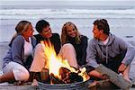 Two Teenage Couples Sitting near Campfire on Beach    Stock Photo - Premium Rights-Managed, Artist: David Schmidt, Code: 700-00054241