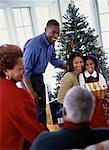 Family Gathered near Christmas Tree