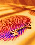 Gold Skeleton Key on Fingerprint    Stock Photo - Premium Rights-Managed, Artist: Keith Ballinger, Code: 700-00055215