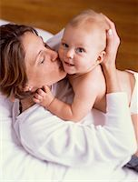 daughter kissing mother - Mother Kissing Baby    Stock Photo - Premium Rights-Managed, Artist: Kevin Dodge, Code: 700-00055245