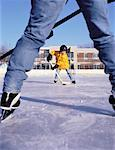 Father and Son Playing Hockey on Outdoor Ice Rink    Stock Photo - Premium Rights-Managed, Artist: Dan Lim, Code: 700-00055379