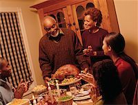 Grandfather Bringing Turkey to Thanksgiving Dinner Table    Stock Photo - Premium Rights-Managednull, Code: 700-00055597