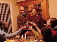 Family Toasting with Glasses at Thanksgiving Dinner Table    Stock Photo - Premium Rights-Managednull, Code: 700-00055599