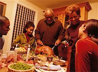 Grandfather Carving Turkey at Thanksgiving Dinner Table    Stock Photo - Premium Rights-Managednull, Code: 700-00055667