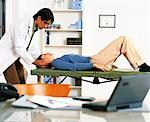 Male Physiotherapist Stretching Female Patient's Neck    Stock Photo - Premium Rights-Managed, Artist: Masterfile, Code: 700-00055922