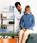 Male Physiotherapist Stretching Female Patient's Neck    Stock Photo - Premium Rights-Managed, Artist: Masterfile, Code: 700-00055923