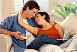 Couple Sitting on Sofa with Portable DVD Player    Stock Photo - Premium Rights-Managed, Artist: MTPA Stock, Code: 700-00058492