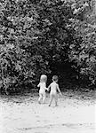 Back View of Nude Children Walking on Beach