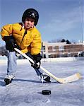 Portrait of Boy Playing Hockey At Outdoor Ice Rink    Stock Photo - Premium Rights-Managed, Artist: Dan Lim, Code: 700-00058739