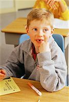 Portrait of Boy Sitting at Desk In Classroom    Stock Photo - Premium Rights-Managednull, Code: 700-00058794