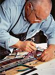 Mature Male Stained Glass Artisan In Workshop