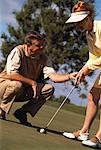 Mature Couple Golfing    Stock Photo - Premium Rights-Managed, Artist: Tim Kiusalaas, Code: 700-00061538