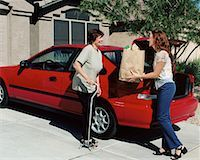 Daughter Handing Bag of Groceries To Mature Mother near Car    Stock Photo - Premium Rights-Managednull, Code: 700-00062279