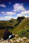 Back View of Man Sitting on Hill Overlooking Landscape Dove Lake, Tasmania, Australia    Stock Photo - Premium Rights-Managed, Artist: R. Ian Lloyd, Code: 700-00062465