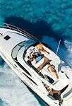 Overhead View of People in Boat Speeding on Water, Bahamas