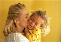 Mother Kissing Daughter on Cheek    Stock Photo - Premium Rights-Managed, Artist: Raoul Minsart, Code: 700-00064993