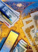 International Currency, Pen Stock Certificates and Gold Bar On Antique World Map    Stock Photo - Premium Royalty-Freenull, Code: 600-00065083