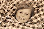 Portrait of Girl Covered in Blanket