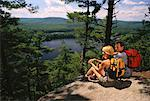 Hiking Couple Sitting on Rocks Belgrade Lakes, Maine, USA    Stock Photo - Premium Rights-Managed, Artist: Peter Barrett, Code: 700-00066382