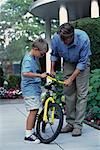 Father and Son Fixing Bicycle Outdoors    Stock Photo - Premium Rights-Managed, Artist: Peter Griffith, Code: 700-00067031