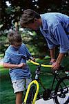 Father and Son Fixing Bicycle Outdoors    Stock Photo - Premium Rights-Managed, Artist: Peter Griffith, Code: 700-00067032