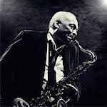 Mature Man Playing Saxophone in Smoky Room    Stock Photo - Premium Rights-Managed, Artist: Philip Rostron, Code: 700-00067068