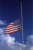 flag at half mast - American Flag at Half Mast with Clouds in Sky    Stock Photo - Premium Royalty-Freenull, Code: 600-00067519