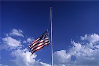 flag at half mast - American Flag at Half Mast with Clouds in Sky    Stock Photo - Premium Royalty-Freenull, Code: 600-00067520