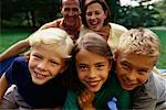 Portrait of Family in Park Toronto, Ontario, Canada    Stock Photo - Premium Rights-Managed, Artist: Peter Griffith, Code: 700-00068503