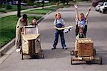 Group of Children Racing Soapbox Cars