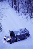 Mature Man Shovelling Snow in Front of Car    Stock Photo - Premium Rights-Managednull, Code: 700-00069905
