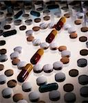 Scattered Pills Forming Dollar Sign    Stock Photo - Premium Rights-Managed, Artist: Gary Gerovac, Code: 700-00069923