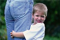 Portrait of Boy Holding on to Mother's Leg    Stock Photo - Premium Rights-Managednull, Code: 700-00070273