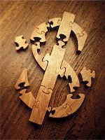 Wooden Jigsaw Puzzle Forming Dollar Sign    Stock Photo - Premium Royalty-Freenull, Code: 600-00070675