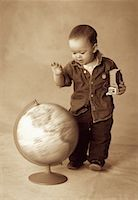 Boy Standing near Spinning Globe    Stock Photo - Premium Rights-Managednull, Code: 700-00070704