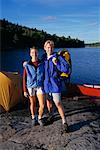 Portrait of Couple Standing near Lake with Tent and Canoe Haliburton, Ontario, Canada    Stock Photo - Premium Rights-Managed, Artist: Greg Stott, Code: 700-00071221