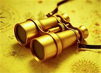 Binoculars on Antique Map    Stock Photo - Premium Royalty-Freenull, Code: 600-00072412
