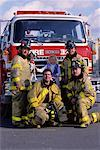 Group Portrait of Male Firefighters by Fire Engine with Girl and Dalmatian    Stock Photo - Premium Rights-Managed, Artist: Philip Rostron, Code: 700-00075527