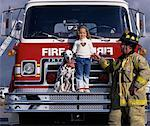 Mature Male Firefighter with Girl And Dalmatian on Fire Truck    Stock Photo - Premium Rights-Managed, Artist: Philip Rostron, Code: 700-00076179