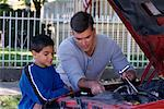 Father and Son Repairing Car    Stock Photo - Premium Rights-Managed, Artist: David Schmidt, Code: 700-00077191