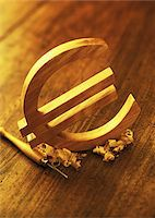 Wooden Euro Symbol and Carving Tool    Stock Photo - Premium Royalty-Freenull, Code: 600-00077467