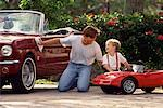 Father Polishing Car with Son Polishing Toy Car    Stock Photo - Premium Rights-Managed, Artist: Marc Vaughn, Code: 700-00078276