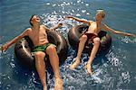 Two Boys in Swimwear on Inner Tubes in Water    Stock Photo - Premium Rights-Managed, Artist: Roy Ooms, Code: 700-00079377